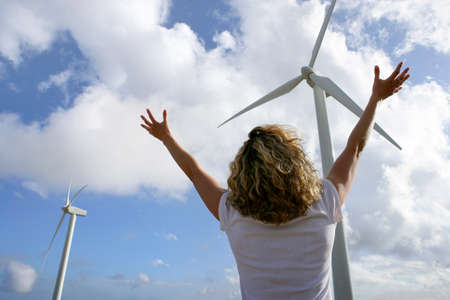 inexhaustible: Woman in front of wind turbines
