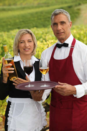 waiter and waitress serving wine photo