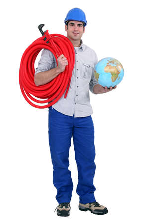 Workers of the world and ball roll tube Stock Photo - 11934846