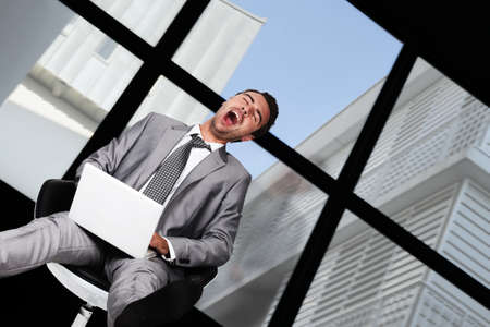 slacker: Businessman laughing hysterically Stock Photo