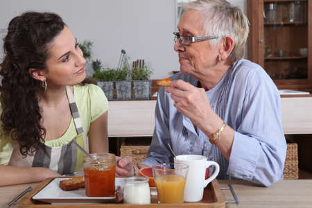 Two women talking over breakfast photo