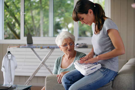tasks: young woman helping senior lady with the housework