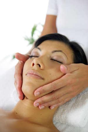 30 s: Woman receiving face massage Stock Photo