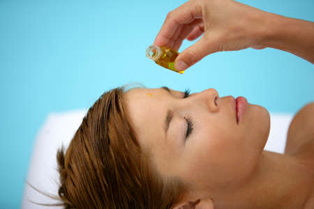 body oil: Woman having a spa treatment