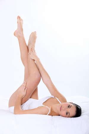 striking: Woman striking leg in bed Stock Photo