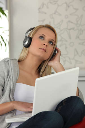 a young woman listening music photo