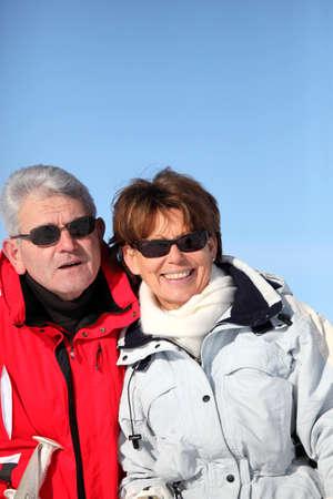 2 50: Adult couple skiing