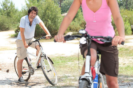 17 19 years: Couple riding bikes in the countryside Stock Photo