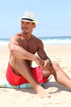 bare chested: handsome man on the beach