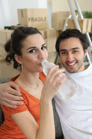 woman drinking water from bottle photo