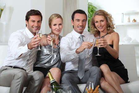 Couples drinking champagne Stock Photo - 11947195