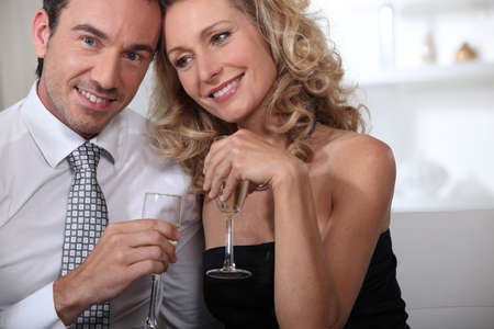 accomplices: couple having champagne Stock Photo