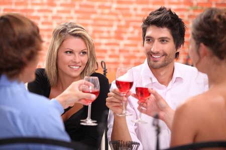 Two couple at a restaurant photo