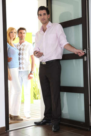 accommodation broker: Estate agent showing couple around property