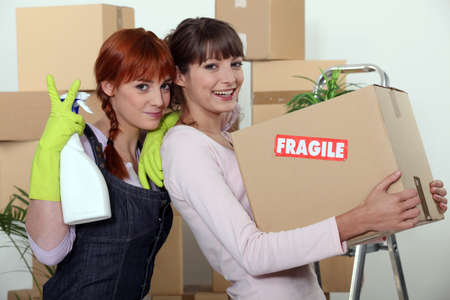 property ladder: Two female friends moving house Stock Photo