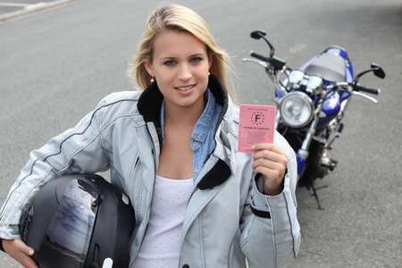 Young woman with motorcycle and French license photo
