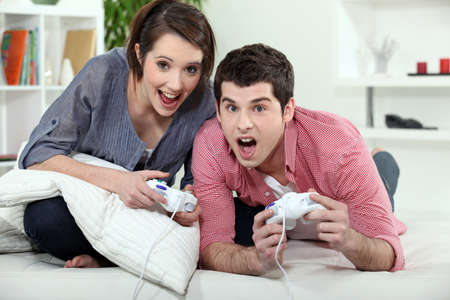 young couple playing video games photo