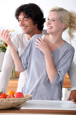 simple meal: couple laughing in the kitchen
