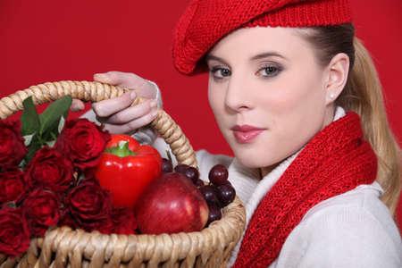 Woman holding winter fruit basket Stock Photo - 11947104