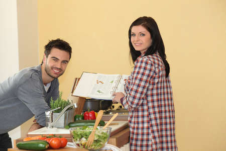 Couple cooking together at home photo