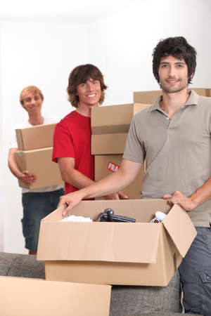 room mate: Young men moving boxes