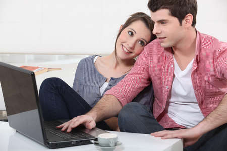 obsession: Couple with a laptop Stock Photo