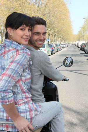 Couple on a scooter Stock Photo - 11946765
