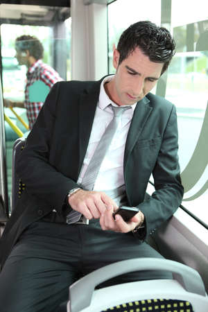 Businessman looking at mobile phone photo