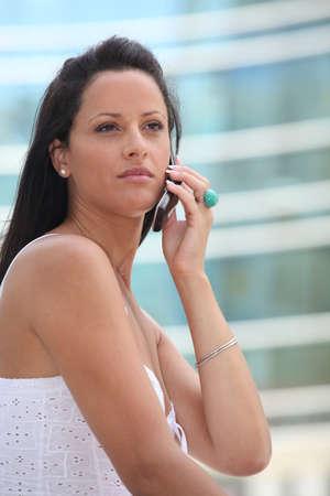 ravishing: Woman on mobile phone Stock Photo