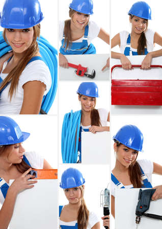 Smiling girl plumber in dungarees photo