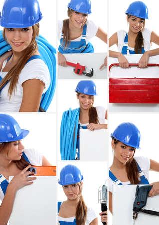 spirit level: Smiling girl plumber in dungarees Stock Photo