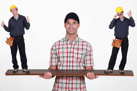 Man balancing tiny workers on plank of wood photo