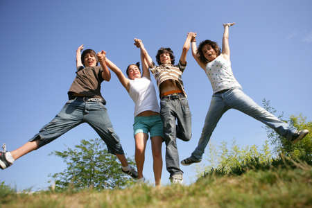 four teenagers jumping photo