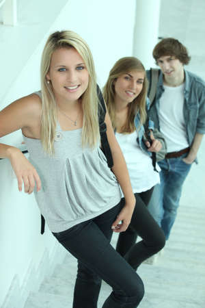 school time: portrait of 3 teenagers in stairs