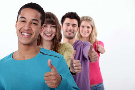 permission: Group of young people giving the thumbs-up Stock Photo