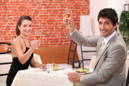 Couple drinking wine in restaurant photo