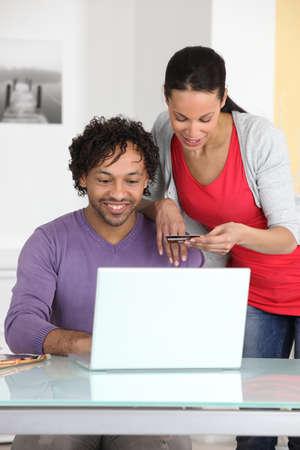 Couple shopping online photo