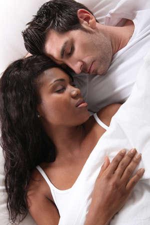 interracial couple sleeping Stock Photo - 11946736