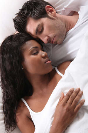 interracial relationships: interracial couple sleeping