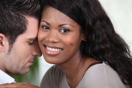 sensuous: Affectionate mixed-race couple