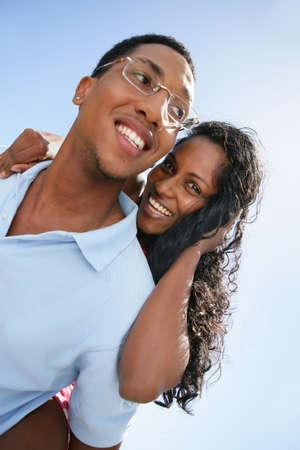 minority couple: Couple stood outdoors on sunny day