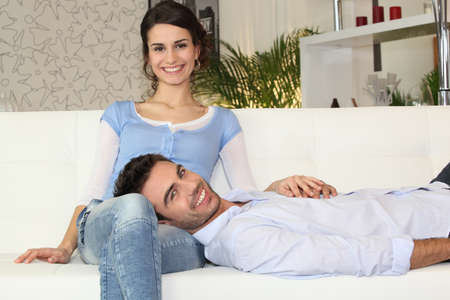 Happy couple on a sofa photo