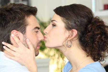 woman kissing her boyfriend photo