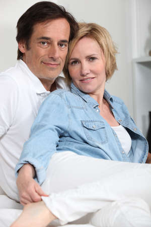30 to 40: Portrait of loving couple sitting indoors