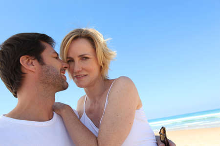 passionately: Couple on the beach