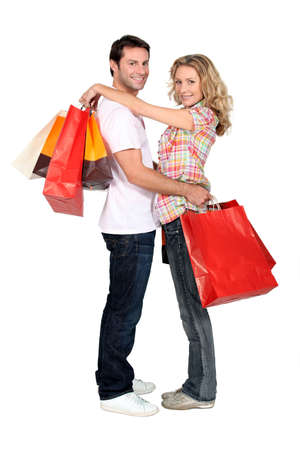 spender: Couple with store bags Stock Photo