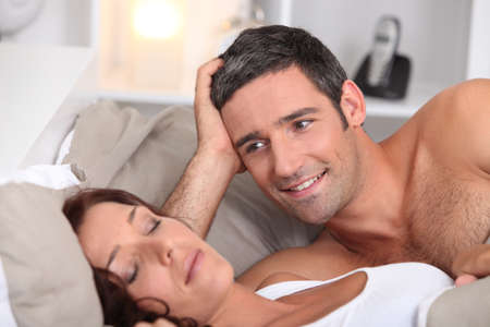 a man looking a wife sleeping deeply photo