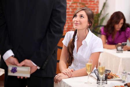 giving back: Man woman waiting at restaurant