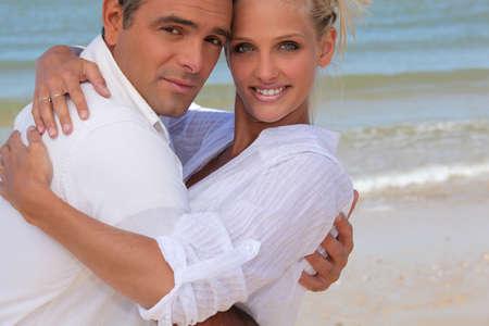 facing: Couple on the beach