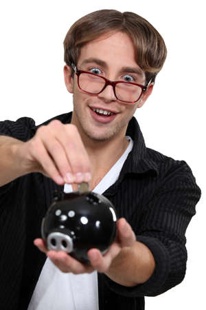 Geeky man saving money photo